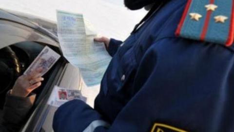 Иностранец поплатится за попытку подкупить дорожного полицейского