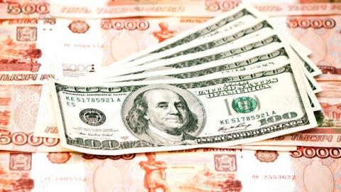 Эксперты прогнозируют рост курса доллара до 59 рублей