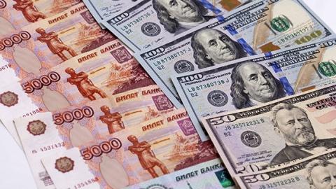 ЦБ снизил курс доллара на19 копеек