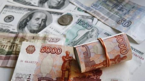 Рубль подешевел на 47 копеек по сравнению с долларом