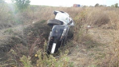 Пассажир опрокинувшейся иномарки только что умер на руках врачей