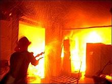 Пожарные вынесли ребенка из горящего дома